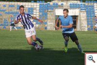 Gerc-Tirana-ai-djathtas-me-bluze-blu